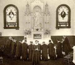 Black and white photo of men praying