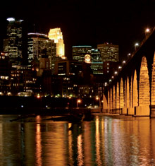 Downtown Minneapolis at night along the Stone Arch Bridge