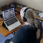 Mary Hess in front of a computer on a video call