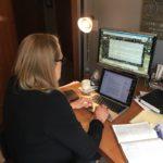 Terri Elton in front of her computer