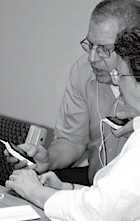 Biblical Preaching D.Min. students Gene Zeller and Mary Gustafson go over the operation of the Creative ZEN MP3 player they will use in their studies.