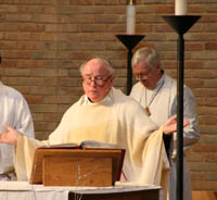 Seminary Pastor John Mann (left) leads chapel service