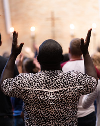Luther Seminary Student raised his hands in worship