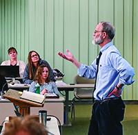 Professor Craig Koester '80 M.Div. addresses an attentive classroom.