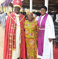 Marie Y. Hayes (center) stands with Archbishop Musa Panti Filibus '98 Ph.D. (right) and his wife, Ruth Musa Filibus.