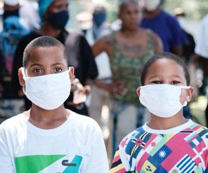 Two masked Black children