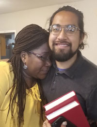 Two Luther Seminary international students hugging